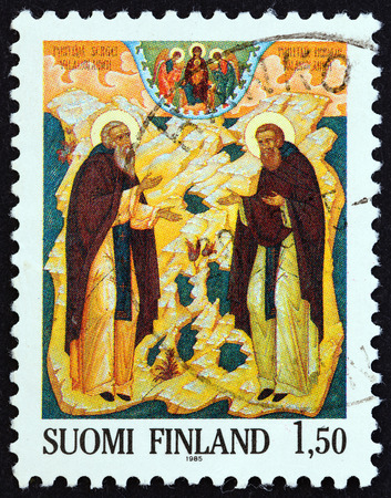 centenary: FINLAND - CIRCA 1985: A stamp printed in Finland issued for the centenary of Saint Sergei and Saint Herman Order shows Saints Sergei and Herman icon, Petros Sasaki, circa 1985.