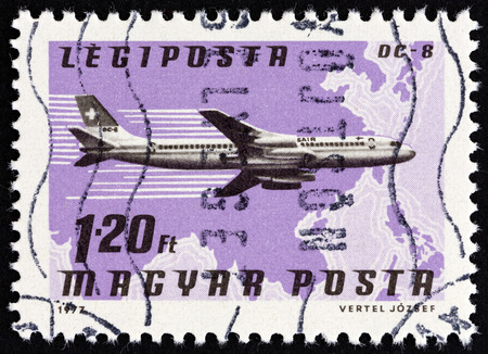 south east asia map: HUNGARY - CIRCA 1977: A stamp printed in Hungary from the Planes, Airlines and Maps issue shows a Douglas DC-8, Swissair and South East Asia map, circa 1977.
