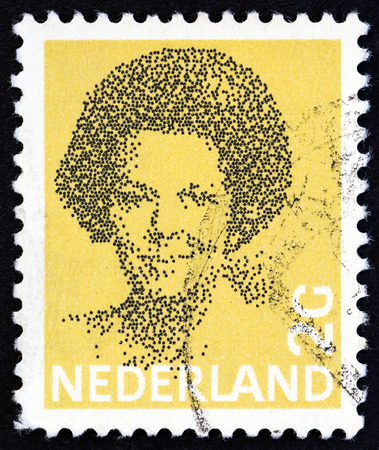 wilhelmina: NETHERLANDS - CIRCA 1982: A stamp printed in the Netherlands shows Queen Beatrix, circa 1982.