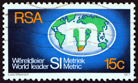 suid: SOUTH AFRICA - CIRCA 1977: A stamp printed in South Africa shows Metrication Symbol on Globe, circa 1977.