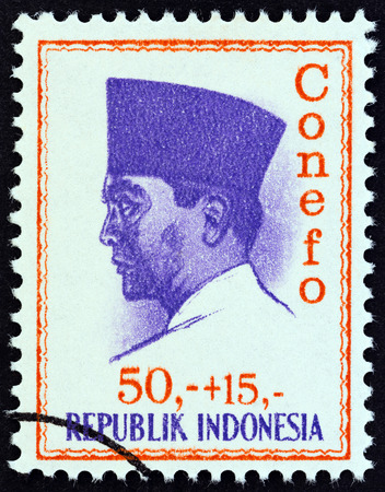 sukarno: INDONESIA - CIRCA 1965: A stamp printed in Indonesia shows president Sukarno commemorating the 1965 Conference of New Emerging Forces, Djakarta Conefo, circa 1965. Editorial