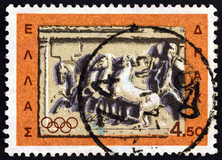 ancient olympic games: GREECE - CIRCA 1964: A stamp printed in Greece from the Olympic Games, Tokyo issue shows Chariot racing, marble votive relief, circa 1964. Editorial