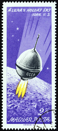 LUNA: HUNGARY - CIRCA 1966: A stamp printed in Hungary issued for the Moon Landing of Luna 9 mission shows Luna 9 in space, circa 1966.