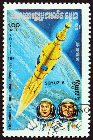 kampuchea: KAMPUCHEA - CIRCA 1984: A stamp printed in Kampuchea from the Space Research  issue shows Soyuz 6 and cosmonauts, circa 1984.