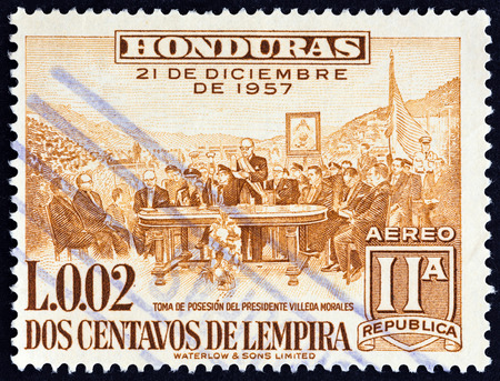 estampilla: HONDURAS - CIRCA 1959: A stamp printed in Honduras issued for the  2nd Anniversary of New Constitution shows Inauguration of President Ramon Villeda Morales, circa 1959. Editorial