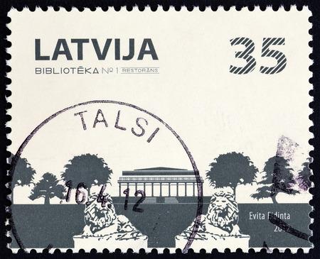LATVIA - CIRCA 2012: A stamp printed in Latvia shows Restaurant in park, circa 2012. Editorial