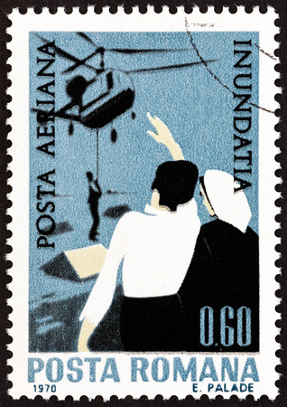 helicopter rescue: ROMANIA - CIRCA 1970: A stamp printed in Romania from the Danube Flood Victims  issue shows Helicopter rescue, circa 1970. Editorial