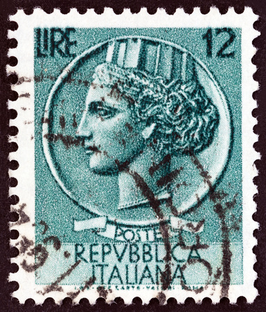 turreted: ITALY - CIRCA 1955: A stamp printed in Italy from the Italy turreted Syracuse issue shows an Ancient coin of Syracuse, circa 1955.