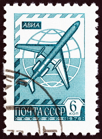 jetliner: USSR - CIRCA 1976: A stamp printed in USSR shows Globe and jetliner Tu-154, circa 1976.