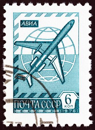 jetliner: USSR - CIRCA 1976: A stamp printed in USSR shows Globe and jetliner Tu-154, circa 1976.