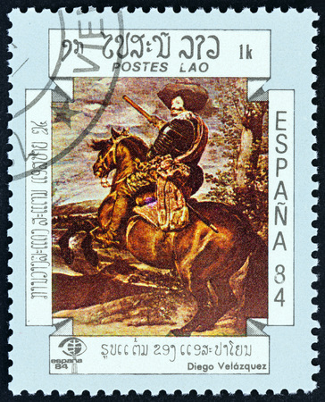 estampilla: LAOS - CIRCA 1984: A stamp printed in Laos from the International Stamp Exhibition Espana 84, Madrid, Spain  issue shows Gaspar de Guzman, Duke of Olivares, on Horseback Velazquez, circa 1984.