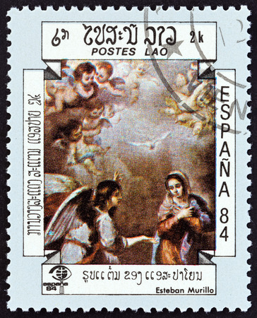 bartolome: LAOS - CIRCA 1984: A stamp printed in Laos from the International Stamp Exhibition Espana 84, Madrid, Spain  issue shows The Annunciation Esteban Murillo, circa 1984.
