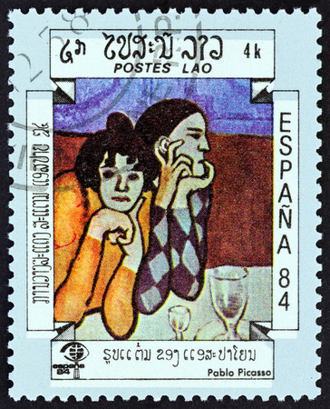 pablo picasso: LAOS - CIRCA 1984: A stamp printed in Laos from the International Stamp Exhibition Espana 84, Madrid, Spain  issue shows Two Harlequins Pablo Picasso, circa 1984.