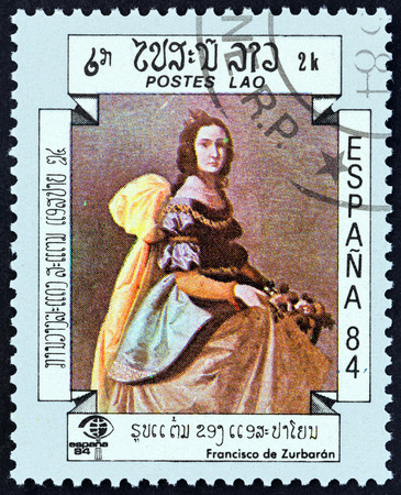 laotian: LAOS - CIRCA 1984: A stamp printed in Laos from the International Stamp Exhibition Espana 84, Madrid, Spain  issue shows Portrait of a Lady Francisco de Zurbaran, circa 1984. Editorial