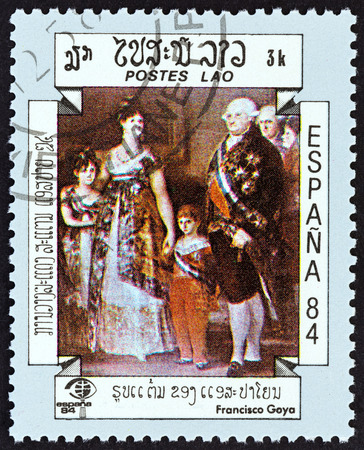 sello: LAOS - CIRCA 1984: A stamp printed in Laos from the International Stamp Exhibition Espana 84, Madrid, Spain  issue shows The Family of Charles IV Francisco Goya, circa 1984. Editorial