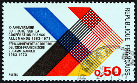 west germany: FRANCE - CIRCA 1973: A stamp printed in France issued for the 10th anniversary of Franco-German Co-operation Treaty shows National Colors of France and West Germany, circa 1973.