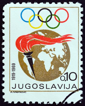 olympic rings: YUGOSLAVIA - CIRCA 1969: A stamp printed in Yugoslavia shows Torch, Globe and Olympic Rings, circa 1969.