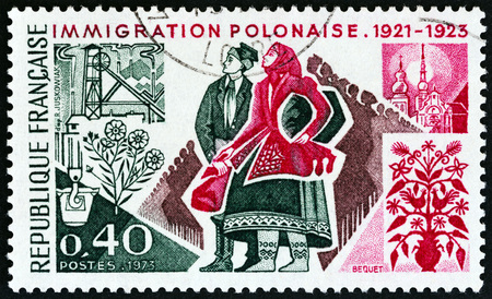timbre: FRANCE - CIRCA 1973: A stamp printed in France from the 50th anniversary of Polish Immigration  issue shows Polish Immigrants, circa 1973. Editorial