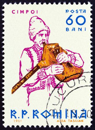 sello: ROMANIA - CIRCA 1961: A stamp printed in Romania from the Musicians  issue shows Bagpiper, circa 1961.