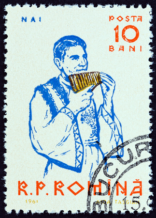 pan flute: ROMANIA - CIRCA 1961: A stamp printed in Romania from the Musicians  issue shows  Pan flute player, circa 1961.