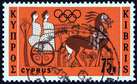 kibris: CYPRUS - CIRCA 1964: A stamp printed in Cyprus from the Olympic Games, Tokyo  issue shows Charioteers, circa 1964.