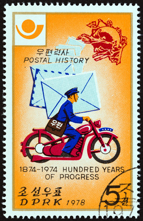 upu: NORTH KOREA - CIRCA 1978: A stamp printed in North Korea from the Postal Progress  issue shows Postman on motorcycle, circa 1978. Editorial