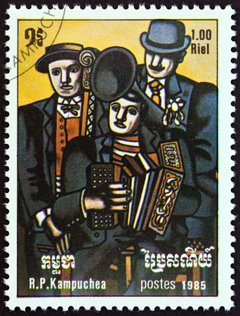 KAMPUCHEA - CIRCA 1985: A stamp printed in Kampuchea from the International Music Year  issue shows Three Musicians by Fernand Leger, circa 1985.