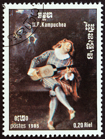 kampuchea: KAMPUCHEA - CIRCA 1985: A stamp printed in Kampuchea from the International Music Year  issue shows Mezzetin by Antoine Watteau, circa 1985. Editorial