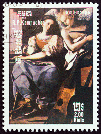 kampuchea: KAMPUCHEA - CIRCA 1985: A stamp printed in Kampuchea from the International Music Year  issue shows St. Cecilia by Bartolomeo Schedoni, circa 1985. Editorial