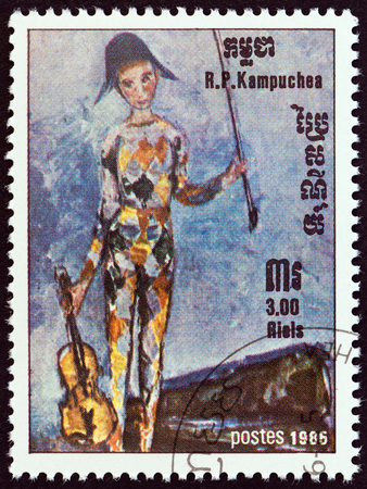 kampuchea: KAMPUCHEA - CIRCA 1985: A stamp printed in Kampuchea from the International Music Year  issue shows Young Harlequin with Violin by Caillard, circa 1985.