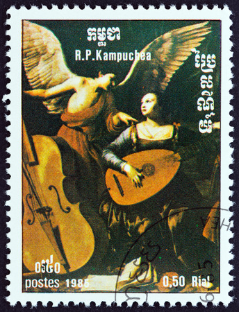 kampuchea: KAMPUCHEA - CIRCA 1985: A stamp printed in Kampuchea from the International Music Year  issue shows St. Cecilia and the Angel by Carlo Saraceni, circa 1985. Editorial
