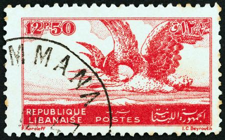 herons: LEBANON - CIRCA 1946: A stamp printed in Lebanon shows Grey Herons, circa 1946.