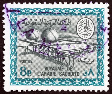 cartouche: SAUDI ARABIA - CIRCA 1966: A stamp printed in Saudi Arabia shows Gas Oil Plant Cartouche of King Saud, circa 1966.