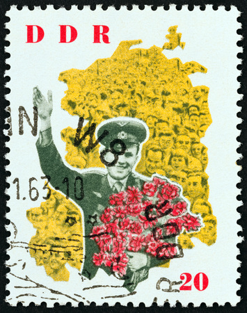 valentina: GERMAN DEMOCRATIC REPUBLIC - CIRCA 1963: A stamp printed in Germany from the Visit of Valentina Tereshkova and Gagarin  issue shows Gagarin with bouquet, circa 1963. Editorial