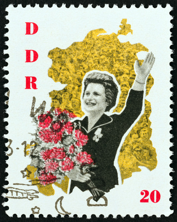 tereshkova: GERMAN DEMOCRATIC REPUBLIC - CIRCA 1963: A stamp printed in Germany from the Visit of Valentina Tereshkova and Gagarin  issue shows Tereshkova with bouquet, circa 1963.