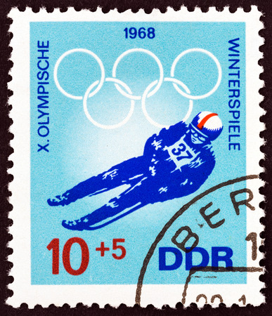 luge: GERMAN DEMOCRATIC REPUBLIC - CIRCA 1968: A stamp printed in Germany from the Winter Olympic Games, Grenoble  issue shows Luger, circa 1968. Editorial