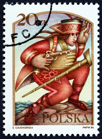 estampilla: POLAND - CIRCA 1986: A stamp printed in Poland from the Folk Tales  issue shows Janosik the Robber, circa 1986.