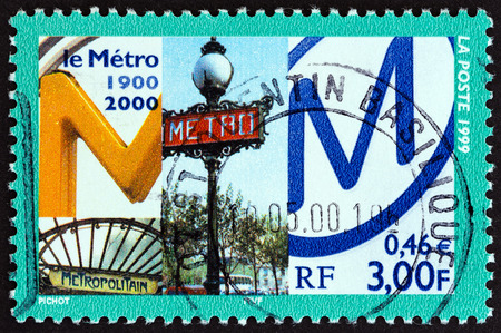 postes: FRANCE - CIRCA 1999: A stamp printed in France issued for the 100th anniversary of Le Metro, Paris shows Metro Signs, circa 1999. Editorial