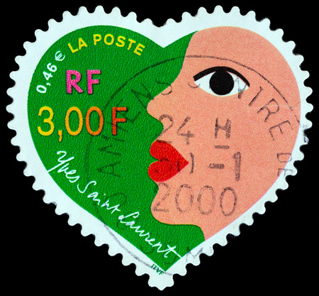 laurent: FRANCE - CIRCA 2000: A stamp printed in France from the St.Valentine Day  issue shows Womans face Yves Saint Laurent, circa 2000. Editorial