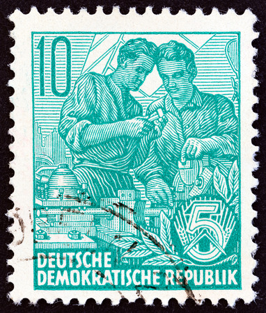 five year: GERMAN DEMOCRATIC REPUBLIC - CIRCA 1953: A stamp printed in Germany from the Five Year Plan issue shows engineers, circa 1953.