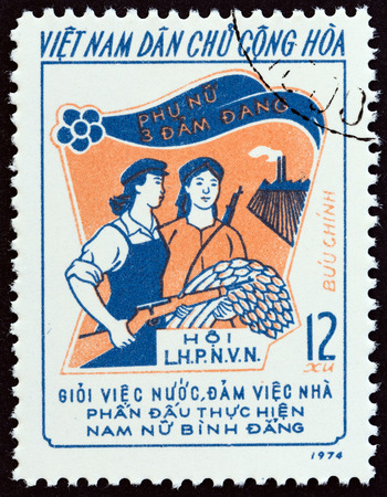 sello: NORTH VIETNAM - CIRCA 1974: A stamp printed in North Vietnam from the Three Responsibilities Women Movement  issue shows Armed Worker and Peasant, circa 1974.