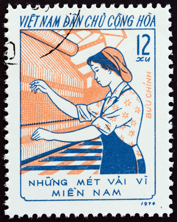 sello: NORTH VIETNAM - CIRCA 1974: A stamp printed in North Vietnam from the Three Responsibilities Women Movement  issue shows Woman operating loom, circa 1974.