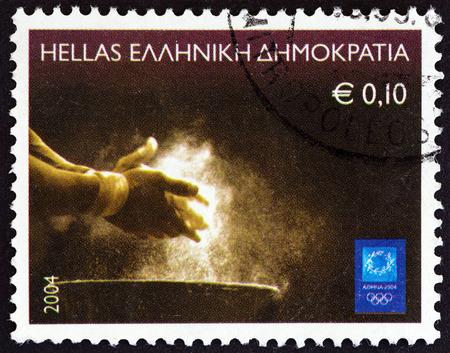 """piscina olimpica: GRECIA - CIRCA 2004: Un sello impreso en Grecia de los """"Juegos Olímpicos, Atenas"""" cuestión pone de manifiesto el levantamiento de pesas, alrededor del año 2004."""