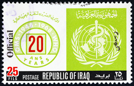 estampilla: IRAQ - CIRCA 1968: A stamp printed in Iraq issued for the 20th anniversary of W.H.O. shows anniversary and W.H.O. emblems, circa 1968. Editorial