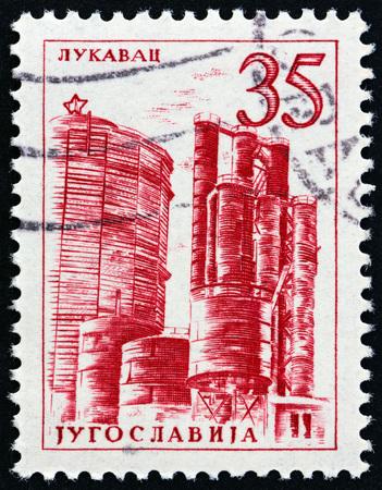 tuzla: YUGOSLAVIA - CIRCA 1958: A stamp printed in Yugoslavia shows Coke plant, Lukavac, circa 1958.
