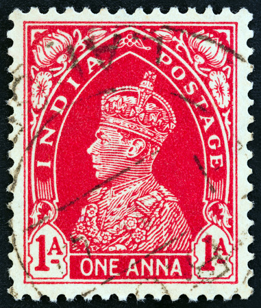 indian postal stamp: INDIA - CIRCA 1937: A stamp printed in India shows King George VI, circa 1937. Editorial