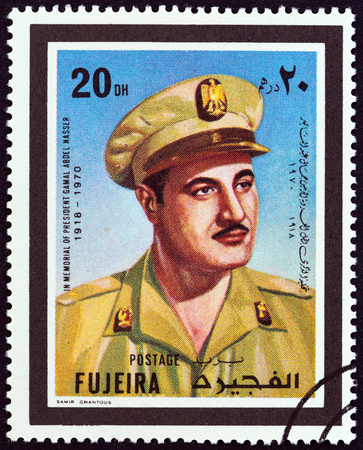 post stamp: FUJAIRAH EMIRATE - CIRCA 1970: A stamp printed in United Arab Emirates shows President of Egypt Gamal Abdel Nasser 1918-1970, circa 1970.