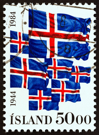 the icelandic flag: ICELAND - CIRCA 1984: A stamp printed in Iceland issued for the The 40th anniversary of Iceland Republic shows Icelandic Flags, circa 1984.