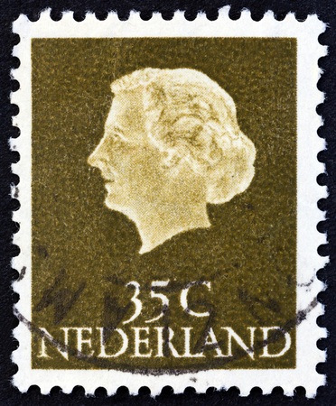 wilhelmina: NETHERLANDS - CIRCA 1954: A stamp printed in the Netherlands shows Queen Juliana, circa 1954. Editorial