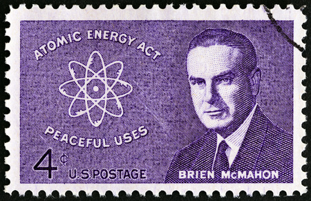 senator: USA - CIRCA 1962: A stamp printed in USA shows Senator Brien McMahon and Atomic Symbol, circa 1962. Editorial